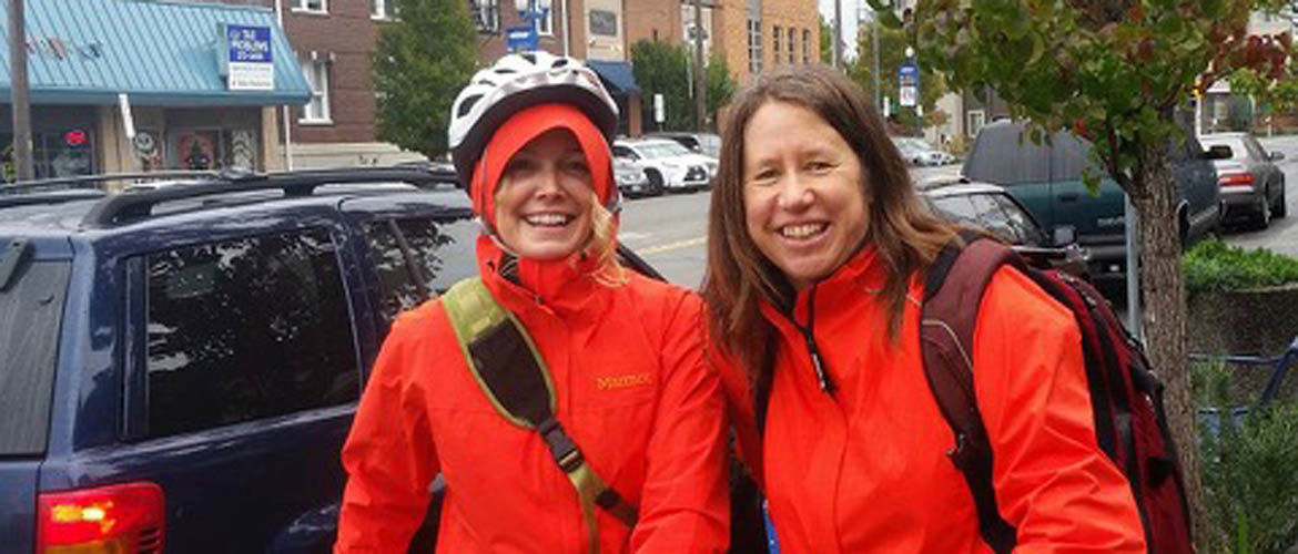 Ellen Moore and Jane Compson Biking in the Rain
